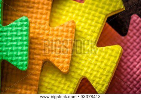 Colorful mat pieces close up