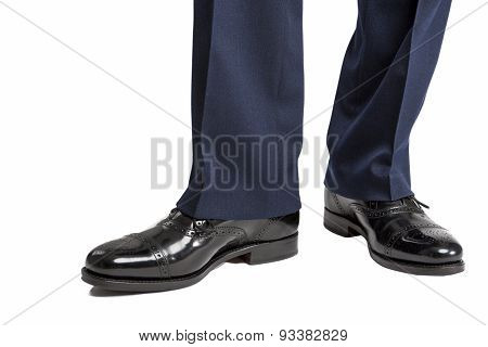 Closeup Of Men's Stylish Semi-brogue Oxford Shoes On A Standing Straight Man. Against White