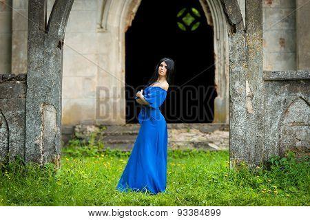 Portrait Of Sensual Fashion Woman In Blue Dress In Church Ruins