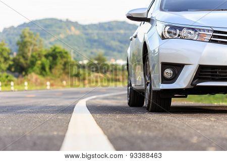 New Silver Car Parking On The Asphalt Road