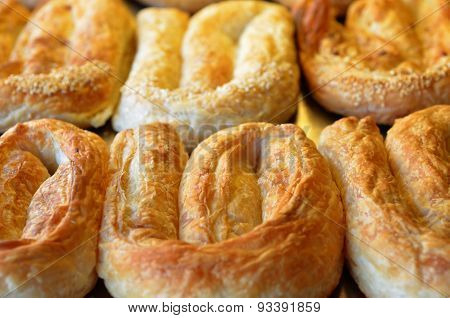 Balkans pastry borek on display in a bakery food background and texture poster
