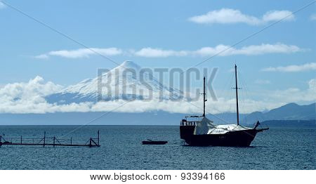 caravel anchored in front of the volcano