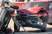 two cars smashed together in a car accident with rollover poster