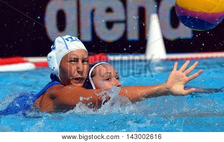 Budapest, Hungary - Jul 16, 2014. RADICCHI Federica (ITA, 2) defending against  CLERC Clemence (FRA, 11). The Waterpolo European Championship was held in Alfred Hajos Swimming Centre in 2014.