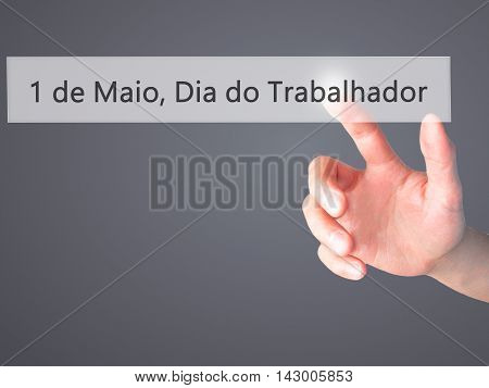 1 De Maio, Dia Do Trabalhador (in Portuguese: 1 May, Labor Day) - Hand Pressing A Button On Blurred