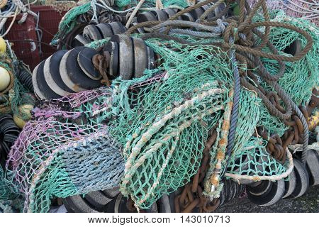 Fishing nets drying on a harbor dock.