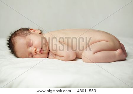 Sleeping baby up to one month newborn on background