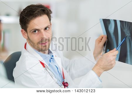 doctor holding x-ray film