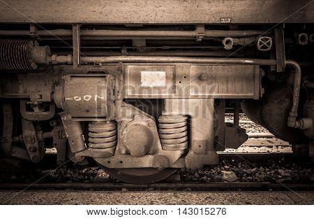 Wheel of Locomotive train in under exposure and selective focus
