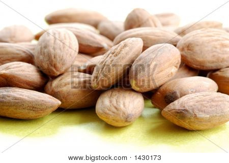 A Pile Of Almonds Against A Yellow Background 1