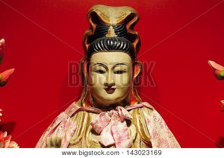 The female guanyin buddha statue within the shanghai cixiu nun temple in Shanghai China.