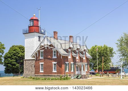 The Dunkirk Lighthouse also known as the Point Gratiot Light shines its beacon over the New York coast of Lake Erie.