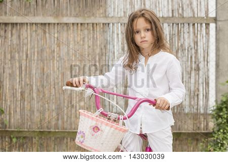 Six year old girl with bicycle