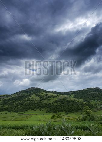 Dramatic skies over Consul hill in Tulcea county, Romania