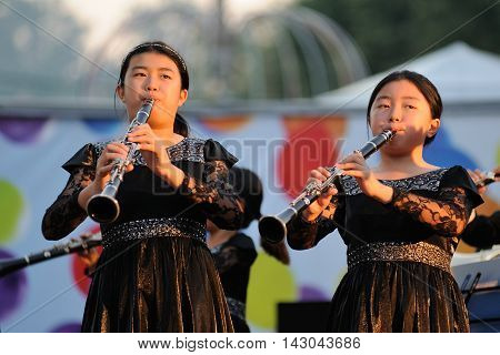 Orel Russia - August 05 2016: Orel city day. Chinese girls playing clarinets on stage