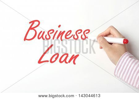 Business woman writing business loan word on whiteboard