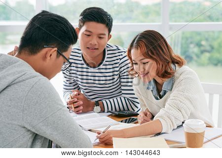 Young female teacher explaining theme to her students
