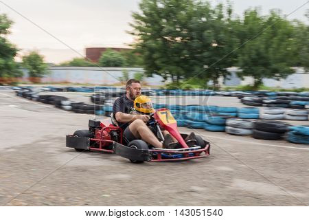 Man and child together go to the sports racing car blurred in motion