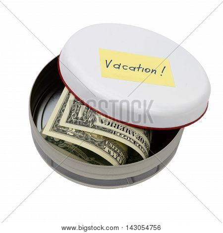 vacation money savings in metal round tin isolated on white backgdround. Travel budget.