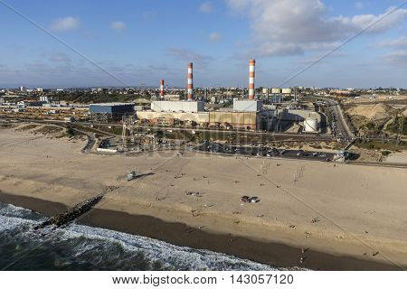 Los Angeles, California, USA - August 6, 2016:  Aerial view of Dockweiler State Beach and LADWP Scattergood generating station on an industrialized section of the southern California coast.