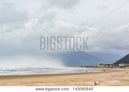 Stormy clouds and rain at Pacific ocean in Rockaway Beach, Oregon