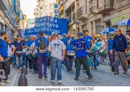 BUENOS AIRES, ARGENTINA - MAY 02, 2016: unidentified men singing and marching against some phone companies.