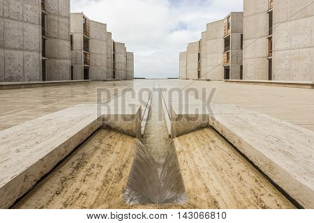 La Jolla, USA - December 10, 2015: Symmetrical architecture of the Salk Institute in San Diego with fountain vanishing point