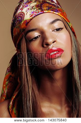 beauty young afro american woman in shawl on head smiling close up swag warm, lifestyle people concept