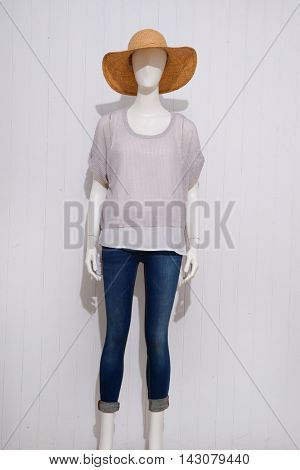 female clothing in jeans with hat on mannequin