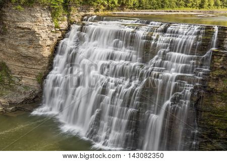 The Genesee River plunges and cascades down the Middle Falls at Letchworth State Park New York.