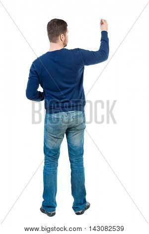 back view of writing business man. Rear view people collection.  backside view of person. Isolated over white background. bearded man in blue pullover draws a felt-tip pen on the board.