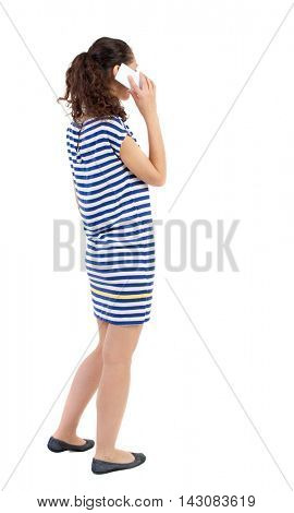 back view of a woman talking on the phone.  backside view of person.  Rear view people collection. Isolated over white background. Swarthy girl in a checkered dress talking on the white smartphone.