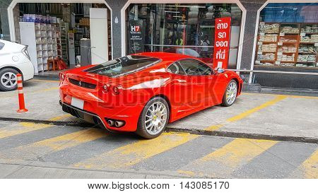 Bangkok,Thailand-Aug 5,2016:Beautiful  luxury sports car Ferrari F430 on the street park in front of a supermarket.