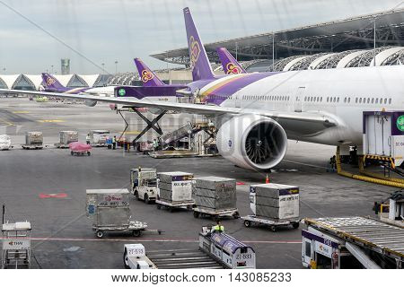 Bangkok,Thailand-Aug 4,2016:Airport officials are focusing on conveying a load of passengers boarding flights to the Thai Airways flight from Bangkok Suvarnabhumi to Singapore Changi Airport.