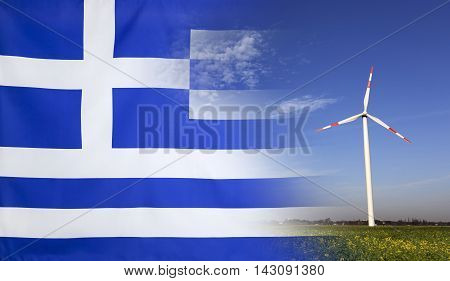 Concept clean energy with flag of Greece merged with wind turbine in a blue sunny sky and green grass with flowers