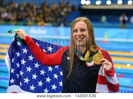 RIO DE JANEIRO, BRAZIL - AUGUST 8, 2016: Lilly King of the United States celebrates winning gold in the Women's 100m Breaststroke Final  of the Rio 2016 Olympic Games at the Olympic Aquatics Stadium