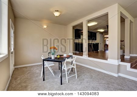 Open Floor Plan Dining Area With Carpet Floor