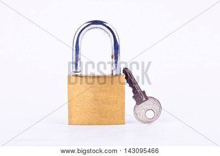 old padlock or master key and key on white background tool isolated