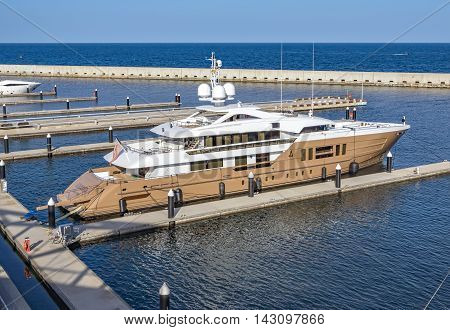 BARCELONA SPAIN - JULY 3 2016: Luxury yacht moored at the harbor