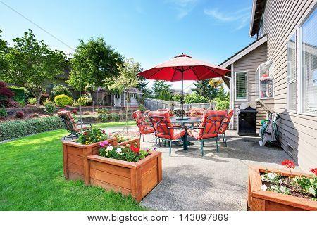 Well Kept Garden At Backyard With Concrete Floor Patio Area