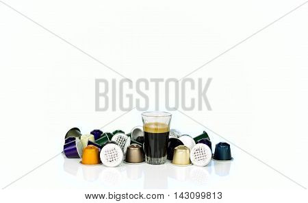 Single-serve espresso shot coffee capsules on white background