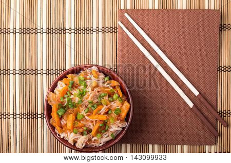 Top View On A Portion Of Rice Vermicelli Hu-teu In A Small Brown Wooden Bowl