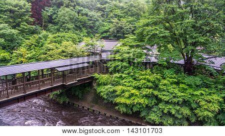 Small bridge at Kurokawa Onsen, a famous hot springs town in Japan.