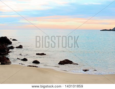 Tranquil scene at the beach. Evening after sunset with colored sky.
