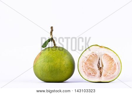 fresh green pomelos and half  pomelo peeled on white background healthy fruit food isolated