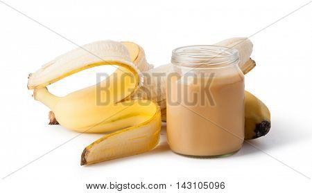Jar with banana baby food isolated on white