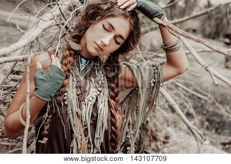 boho woman close up portrait with roots background