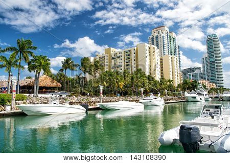 Hotel Buildings With Yachts And Palm Trees