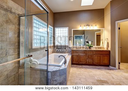 Luxury Bathroom Interior With Vanity With Granite Counter Top, Large Mirror And Tile Floor.