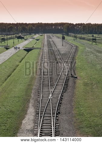 Aerial view of train station with platform in Auschwitz - Birkenau, or Oswiecim - Brzezinka, concentration camp, Poland